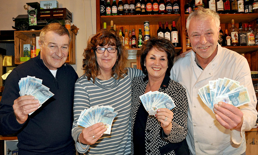 BUNCH OF FIVERS – (left to right) Martin Layton of MSL Designs Group Ltd, Lynette Conroy of Cargo Lounge, Meryl Ponsford of DCCF and William Gardiner of Cargo Lounge celebrate the quiz's success which raised £690 for DCCF's High Five Appeal.